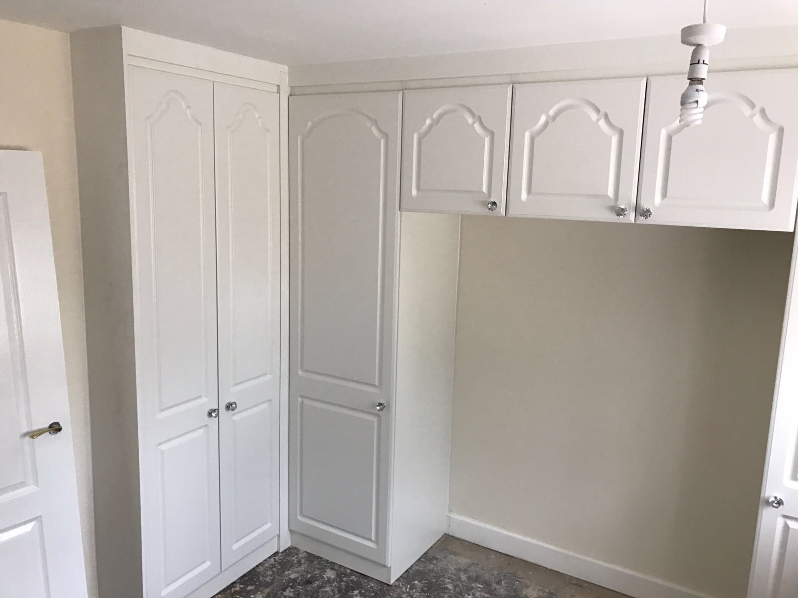 Built in white hinged wardrobe