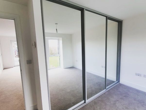 door floor to ceiling glass wardrobe