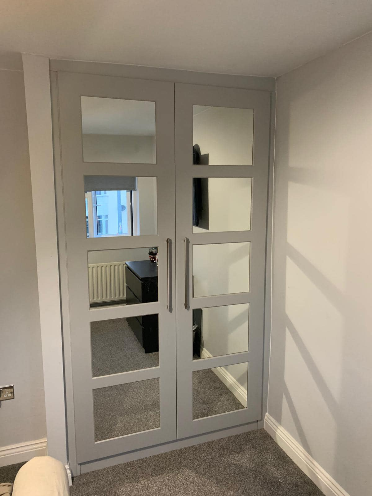 grey and mirrored fitted wardrobe