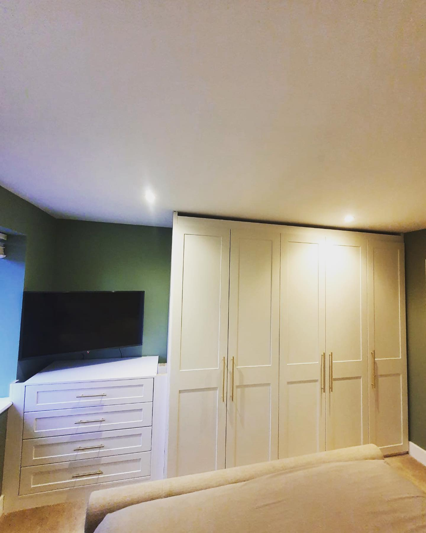 white panelled fitted wardrobes